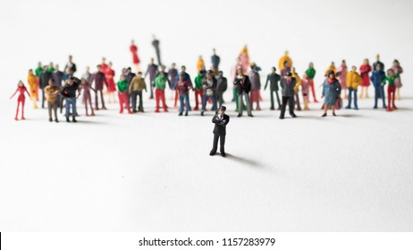 Man in front of a large crowd of followers. Leadership role in business or social media. Person with many followers standing ahead of the crowd. Innovator or influencer is a mentor to a huge crowd.