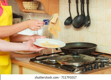Man frying breaded chicken cutlet on fry pan. Person making dinner meal.