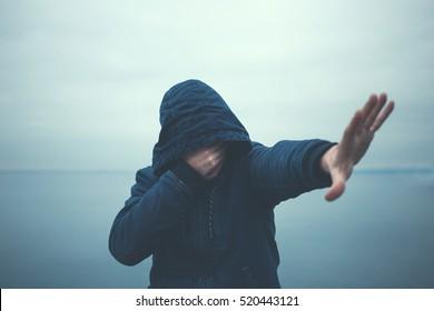man full of shame hide himself crying