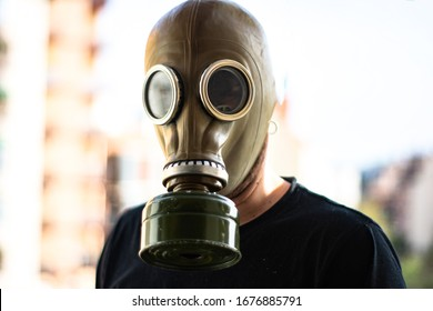 Man with a gas mask in a city. Apocalypse, coronavirus