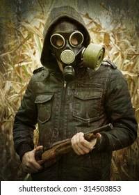 man gas mask gun concept the danger of war rusty grunge background