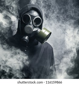 A Man In Gas Mask The Smoke Black Background