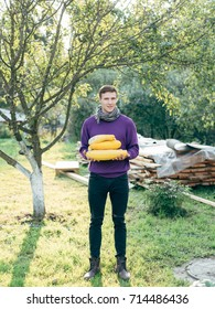 The man gathered a harvest of yellow zucchini. A farmer and a crop of zucchini. Autumn harvest