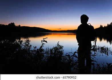 Man gazing out at the night sky shortly after sunset.