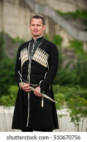 Man in Georgian national dress on a background of mountains