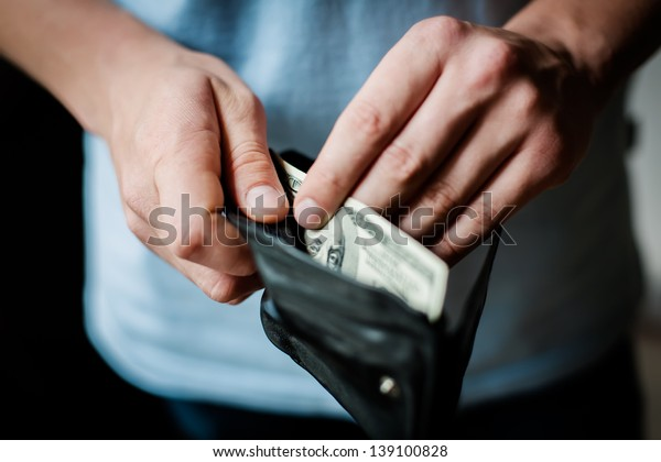Man gets money from the wallet