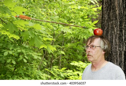 Man getting an apple shot off his head showing trust as arrow is in mid air