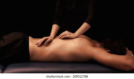 Man getting a back massage at spa
