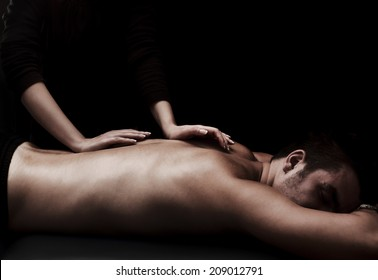 Man getting a back massage at spa