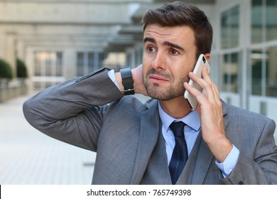 Man getting devastating news on a phone call