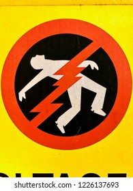 Man getting electrocuted sign