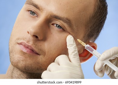 man getting a face cosmetic injection