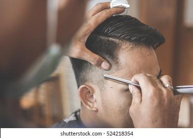 man getting his hair cut at barbershop