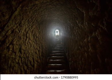 Man getting out of a dark tunnel toward light