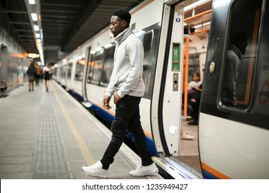 Man getting out of a subway train