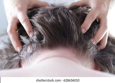 Man getting a professional head massage