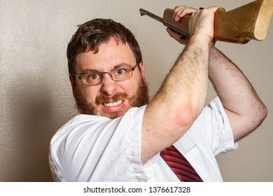 man getting ready to smash his gun against someone