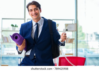 Man getting ready for sports break in the office