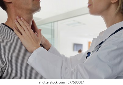 Man getting thyroid gland control. Health care and medical concept