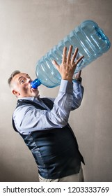 a man with a giant water bottle