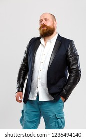 Man with ginger beard in jeans