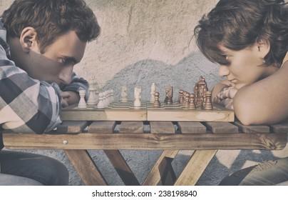 Man and girl playing chess