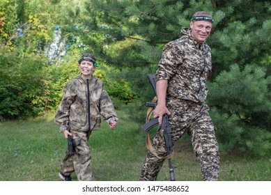 Man and girl playing in lasertag shooting game, father and daughter with a gun, war simulation.