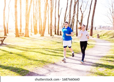 Man and girl training on sunny spring day