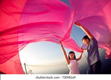 man and girl under the sail