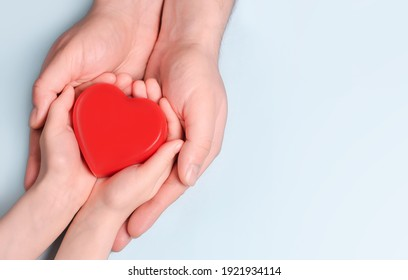 Man give red heart to kid as couple. Healthcare and hospital medical concept. Symbolic of Valentine day.Top view with space for text.