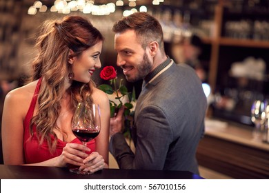 Man give rose to girlfriend in the Valentine's evening