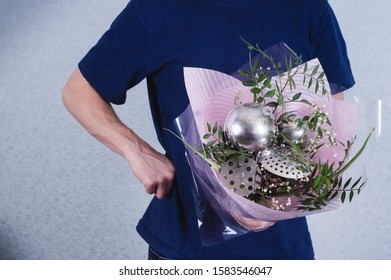 A man gives a bouquet of flowers and ladles. concept of sexism, feminism and patriarchal society and gender inequality.