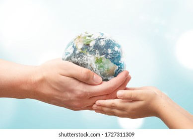 Man gives the Earth globe to the child. World environment day concept. Elements of this image furnished by NASA