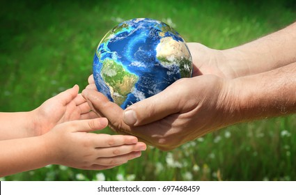 The man gives planet Earth to baby. Ecology concept, earth day. Elements of this image furnished by NASA