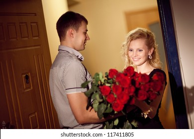 man gives red roses to a girl