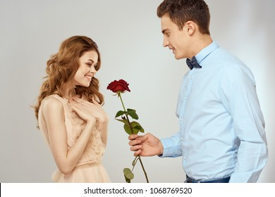man gives a rose to a woman, happiness