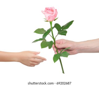 Man gives the woman a flower