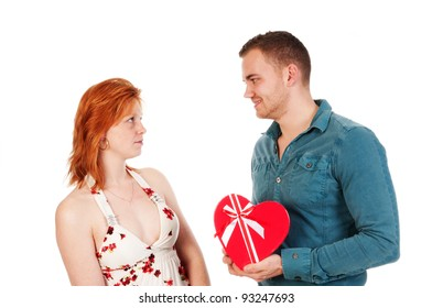 man gives woman a heart shaped box isolated