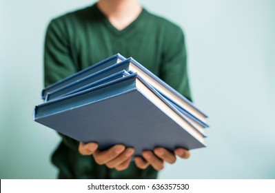Man giving books