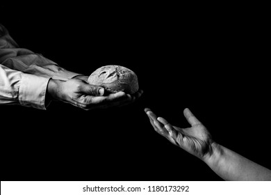 Man giving Bread to person in need. Helping Hand Concept. Black and white
