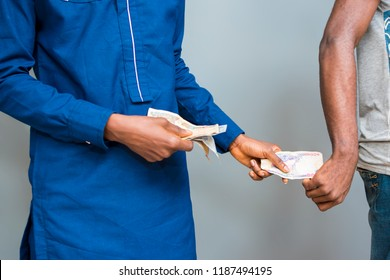 a man giving bribe. a man collecting a bribe