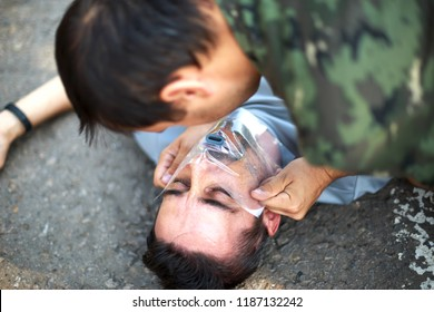 Man giving first aid to a person using mouth-to-mouth breathing. First aid training doing CPR
