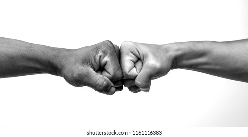 Man giving fist bump, monochrome, black and white image.