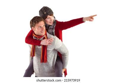 Man giving girlfriend piggy back on white background