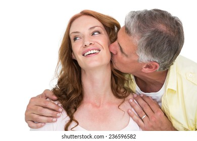 Man giving his partner a kiss on white background