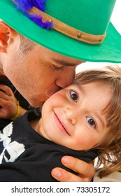 Man giving a kiss in the child girl .