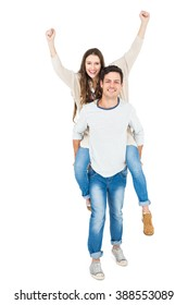 Man giving piggy back to his girlfriend on white background
