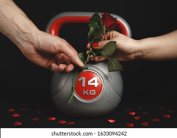 Man giving red rose and heavy kettlebell to a woman as a gift for Valentine's Day.