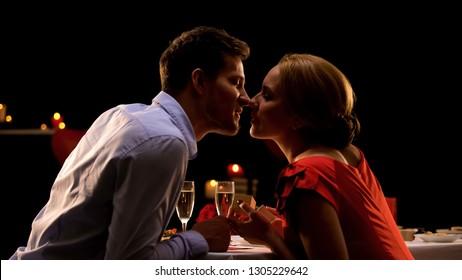 Man giving seductive girlfriend little box with precious present, couple kissing