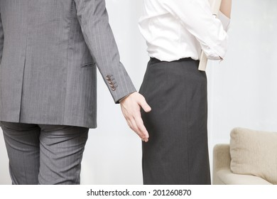 A man giving sexual harassment